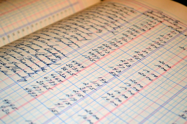 A hand-written     accounting ledger.